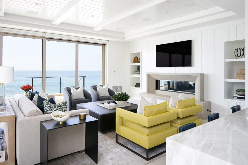 Coastal white living room design by Blackband Design