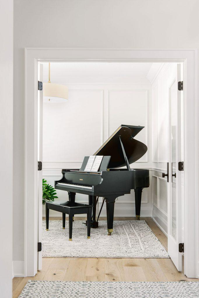 black baby grand piano room paneled walls benjamin moore oc-17 white dove