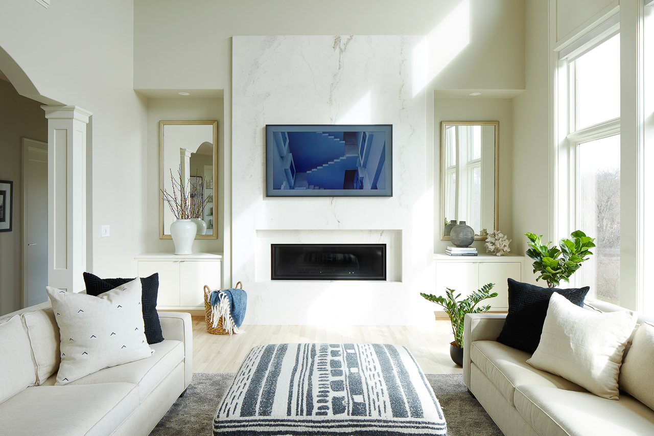 Modern marble fireplace with built ins on each side, linear fireplace with Samsung Frame TV by Jillian Lare Des Moines Interior Designer