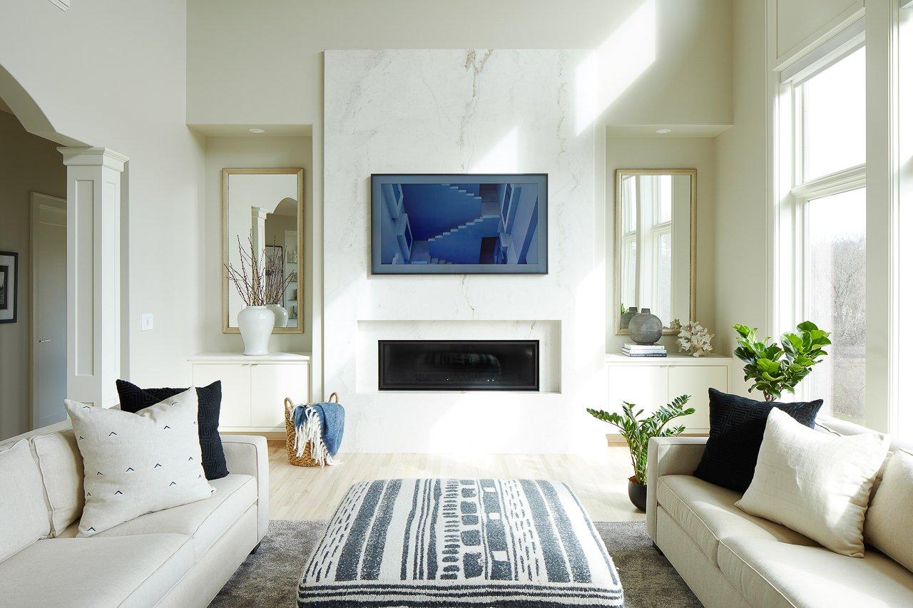 Des Moines Iowa Interior Designer Jillian Lare Contemporary Marble Fireplace Floating Built-ins