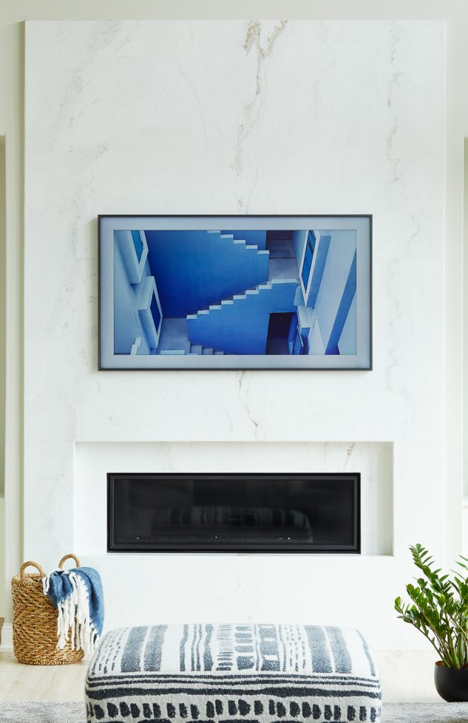 Modern marble slab fireplace, linear fireplace with Samsung Frame TV by Jillian Lare Des Moines Interior Designer
