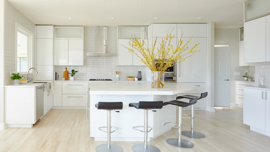 White and gray modern kitchen remodel with high gloss white cabinets by Jillian Lare Des Moines Interior Designer