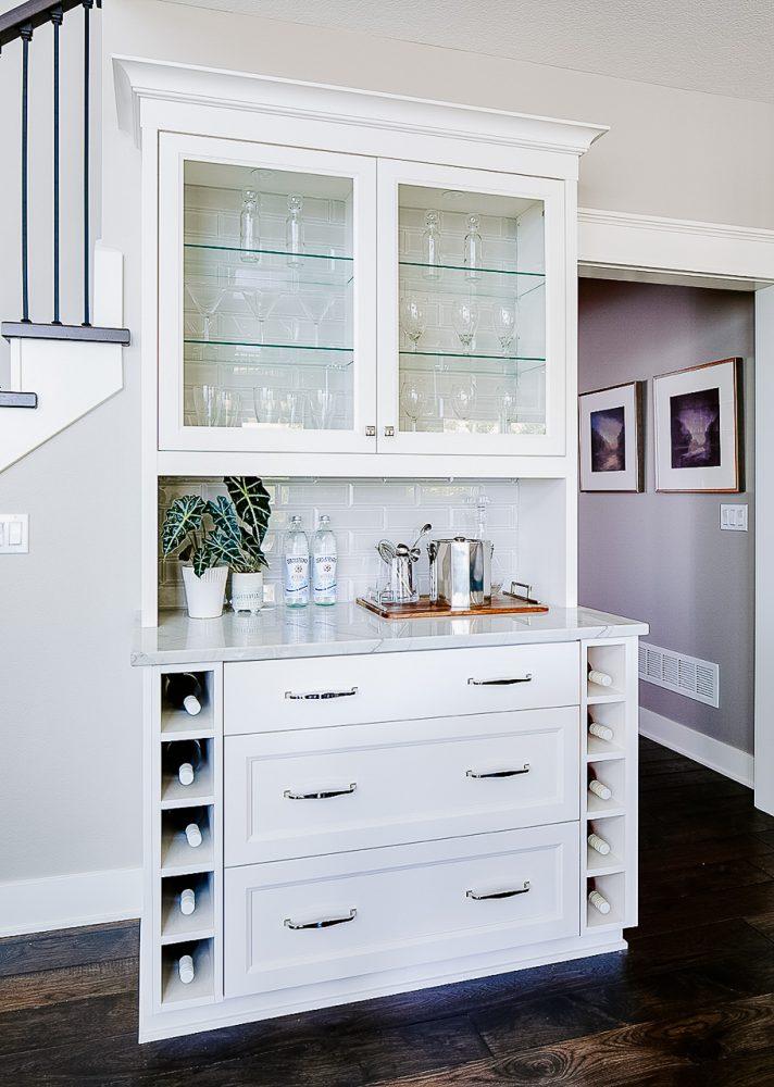 Cabinetry hutch with tiled backsplash, wine storage