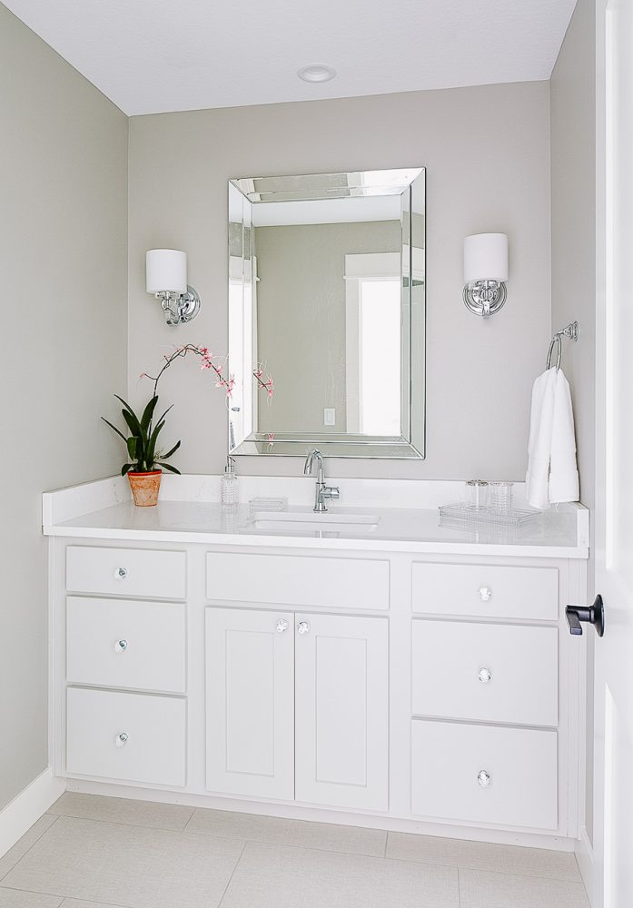 gray and white bathroom with white quartz countertops